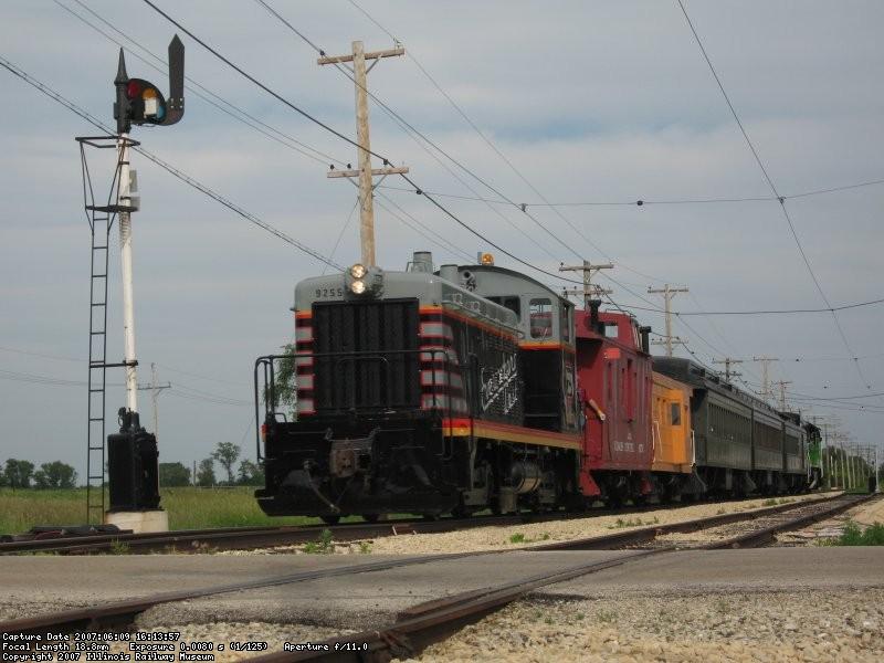 9255 leads a 6 car train across Olson Rd
