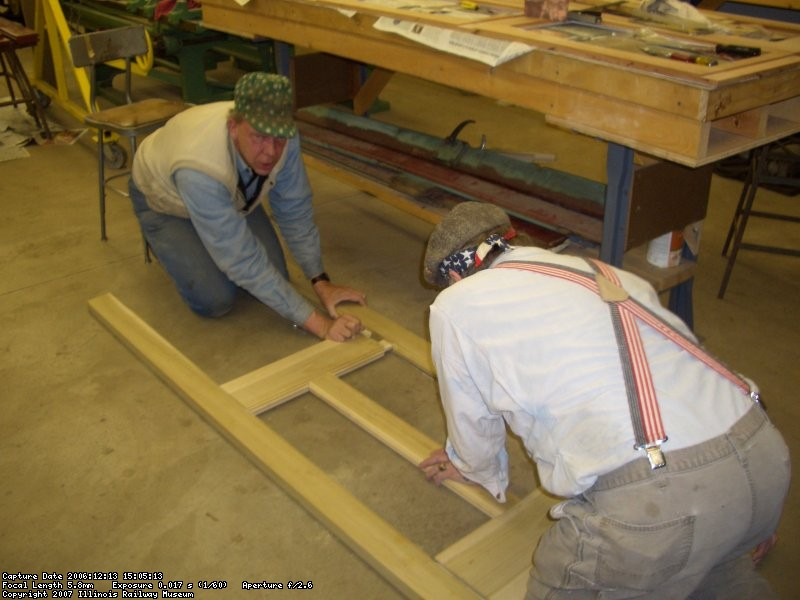 12.13.06 - JOHN NELLIGAN AND BOB KUTELLA ARE TESTING THE FIT OF THE MORTISES AND TENONS WHICH WERE JUST COMPLETED ON A NEW DOOR WHICH THEY ARE MAKING.