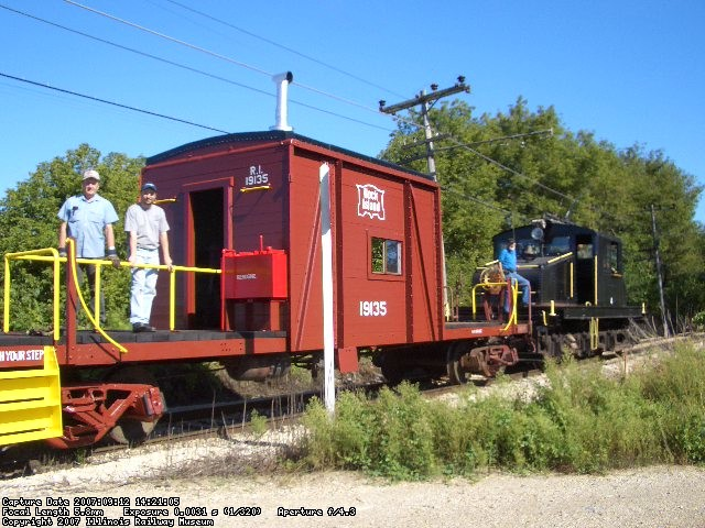 09.12.07 - HENRY VINCENT HAS CHANGED THE POLE PRIOR TO CHANGING DIRECTION ON THE MAINLINE.  JOHN AND JAMES FAULHABER ARE ON THE DECK OF THE CABOOSE, ENJOYING THE RIDE.