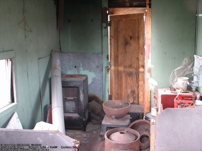 12.14.07 - THIS PHOTO, BY ROBERT KUTELLA, SHOWS THE CONDITION OF THE INTERIOR PRIOR TO RESTORATION.  IT HAD NUMEROUS FIVE GALLON PAINT CANS, PART OF A RADIAL ARM SAW, A DEHUMIDIFIER, A COAL STOVE IN PIECES AND OTHER ASSORTED JUNK INSIDE.  WINDOWS AND DOORS WERE BROKEN, THE WOOD SIDING WAS ROTTEN AND LEAKING AND THE ROOF LEAKED.