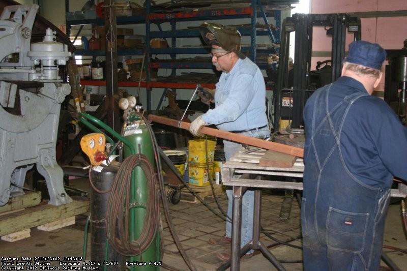 Dennis sets up to make the measuring bar