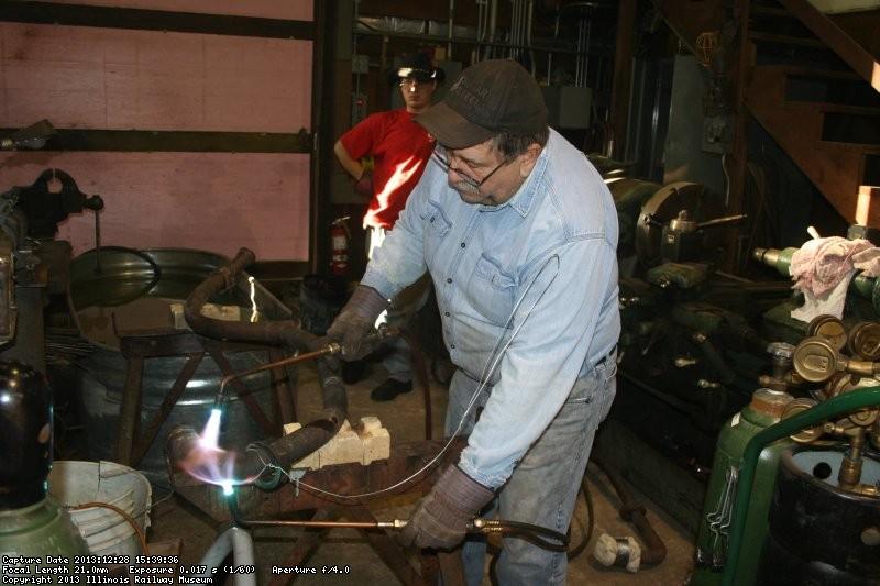 Dennis heats the copper pipe