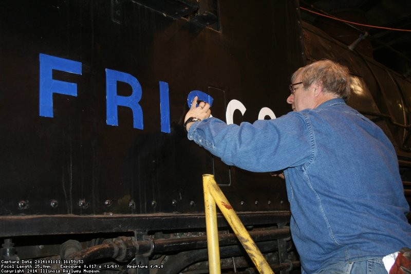 Jim masks the lettering
