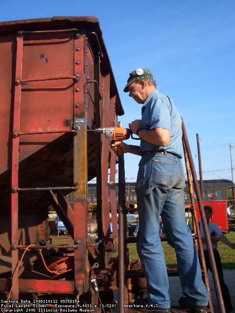 10.12.08 - BOB KUTELLA IS DRILLING ANOTHER HOLE TO MOUNT THE HANDHOLD TO THE REPLACED VERTICAL SUPPORT.