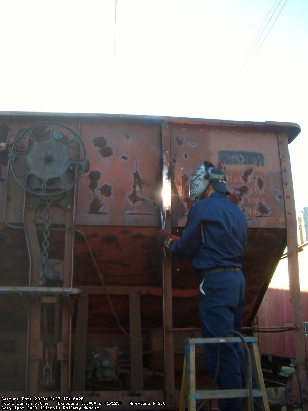 10.07.09 - THE CONTRACT WELDER IS WELDING PART OF A VERTICAL SUPPORT BACK TOGETHER  AFTER CUTTING IT TO HEAT AND STRAIGHTEN THE PART.