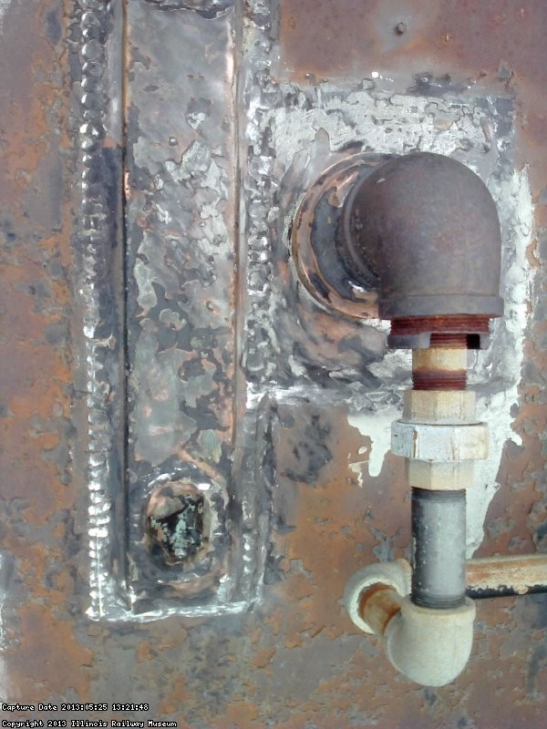 Area of leak identified 5/25/13 - above refrigerator