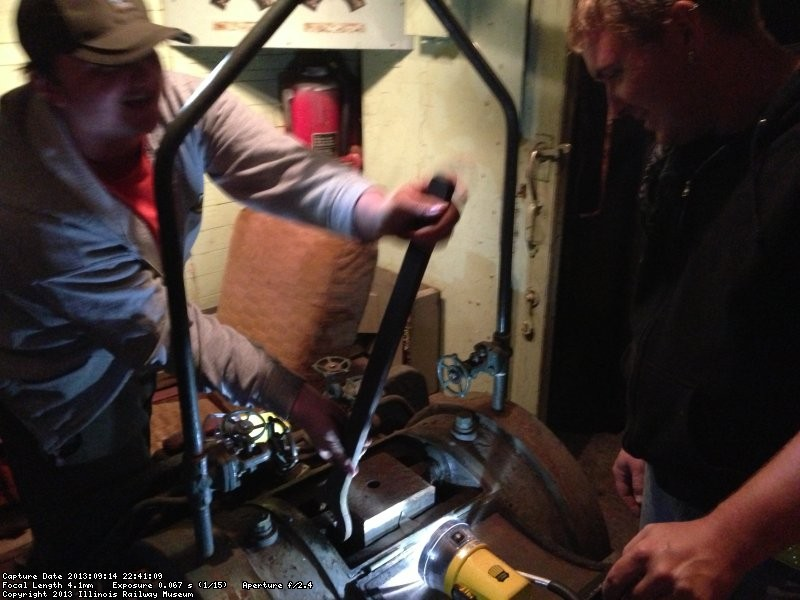 X-5000 volunteer Brian LaKemper (left) and Jeron Glander (right) work on the hydraulic dynamometer unit. 9/14/13.