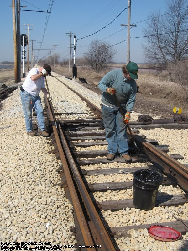 Frank and Steve sweeping and greasing the spring switch at the west end of Johnson Siding