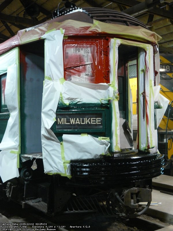 Fresh paint on #2 end of 749. Note the coupler knuckle removed so a diesel could push the car out from under wire.