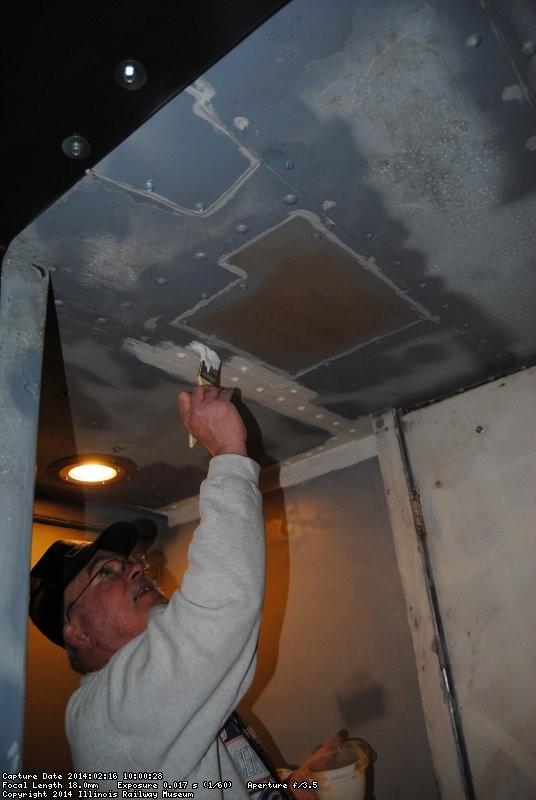Kevin Kriebs applying primer to ceiling in the vestibule between the Exhibit Cars 2/16/14