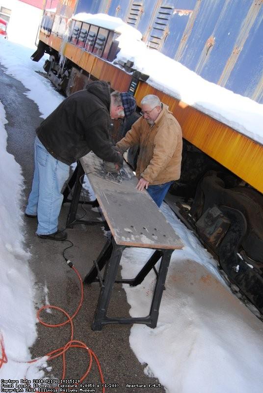 Mike and Mark Gellman sanding the vestibule closet door 2/16/14