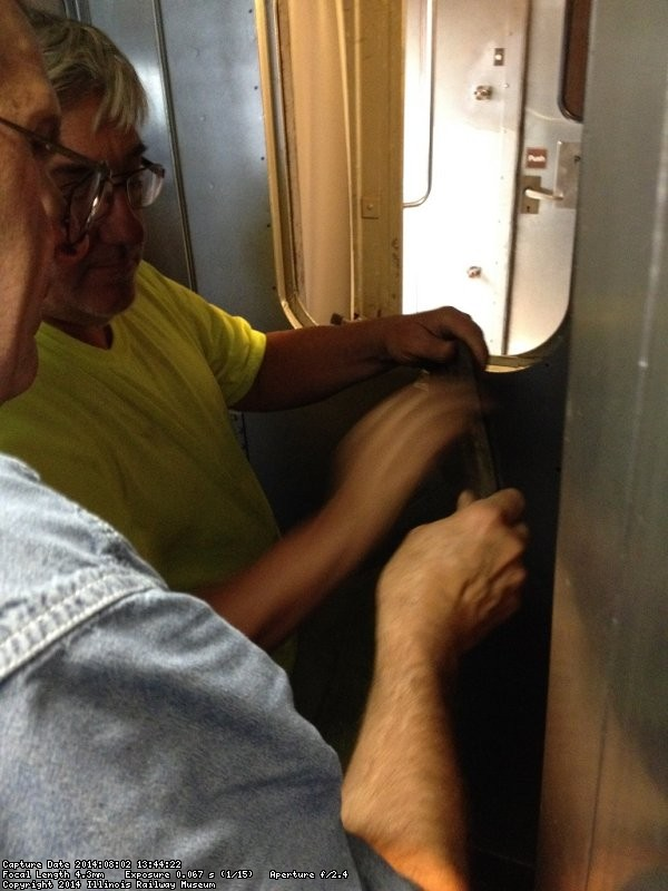 Ray Mormann and Mark Gellman prepare the door window opening - Photo by Michael McCraren