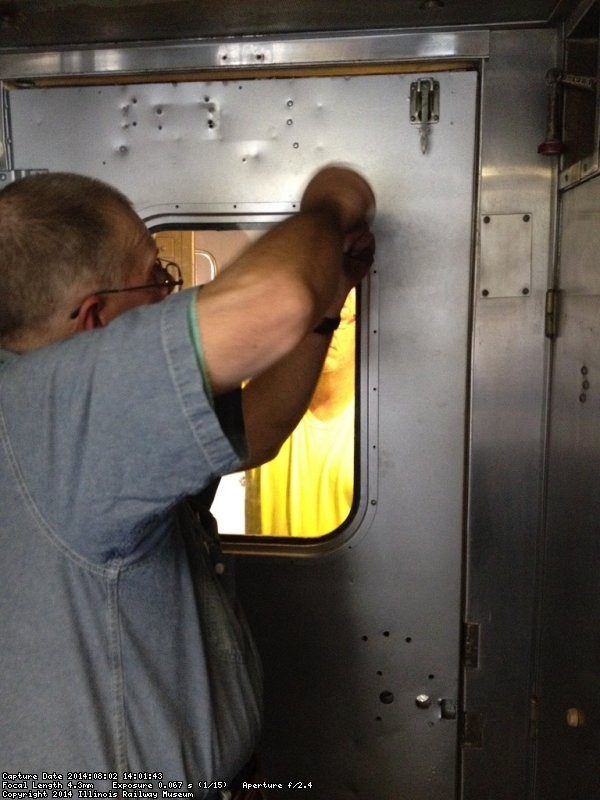 Ray secures the glass in place - Photo by Michael McCraren