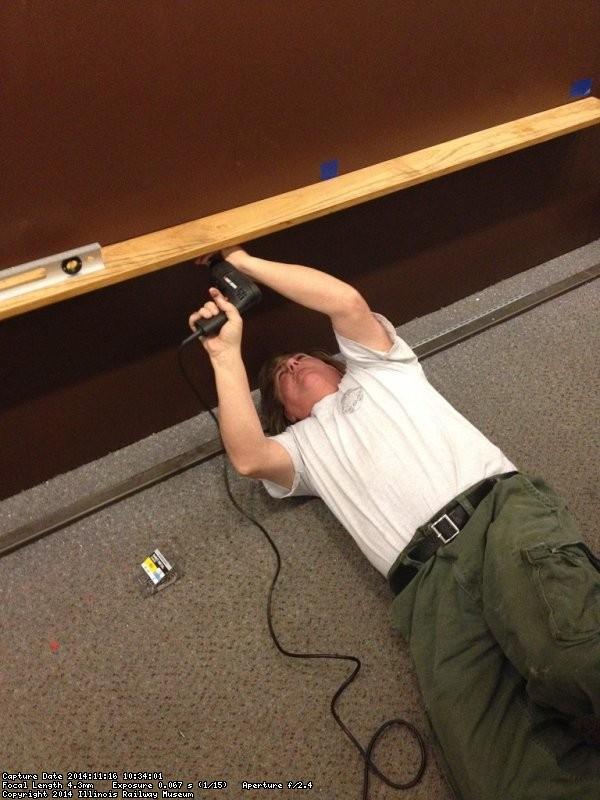 Mark Gellman installing a shelf - Photo by Michael McCraren