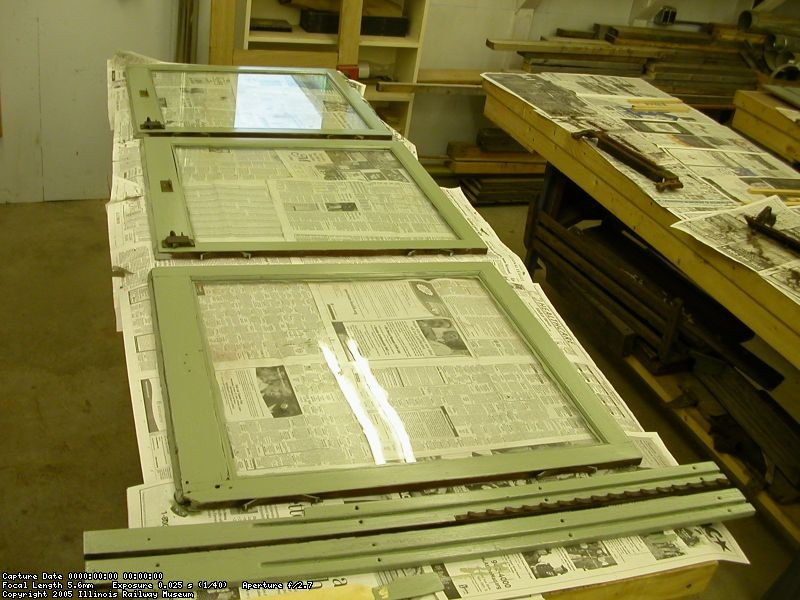 Newly repainted window sash for car 308 on the bench in the wood shop 20 November 2004