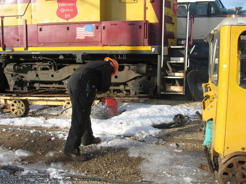 Frank chipping ice from the railhead