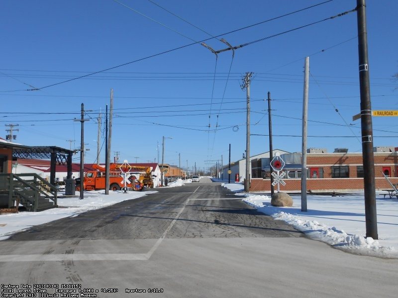 Central Ave. looking East from Railroad Ave.  Double trolley bus wire will begin East of Depot St.  About where the car is parked.