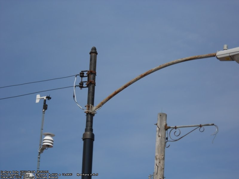 Newly installed steel pole fitted with 1950's era Chicago style pole extension and 8' street light arm.