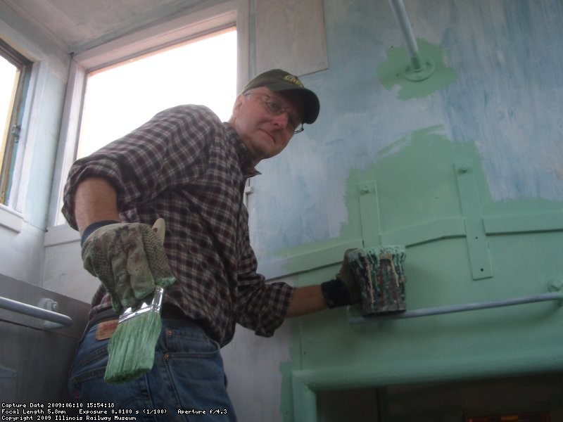 06.10.09 - LEE IS CUTTING IN THE LIGHT GREEN AREAS OF THE CUPOLA.