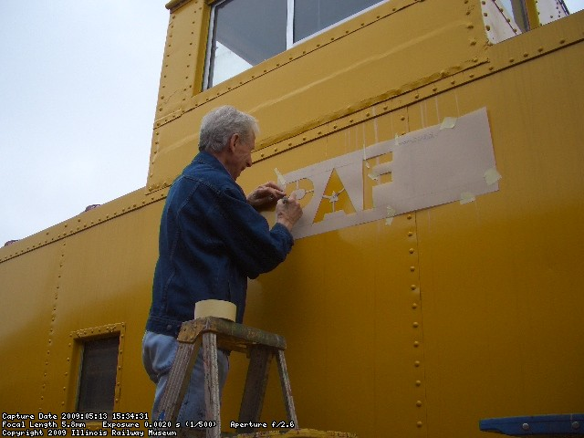 05.13.09 - BILL IS APPLYING THE STENCIL SO THAT HE CAN TRACE THE RAILROAD NAME.