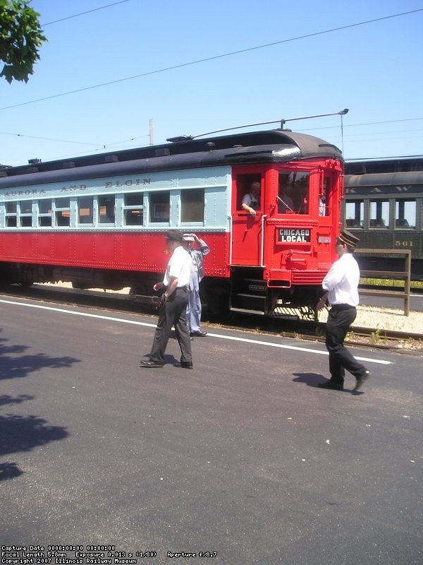 Motorman Randy Hicks (train 308) talks to Motorman Jeff Obarek (train 431) as Frank Hicks and Conductor Jim Pechous (train 431) walk by.