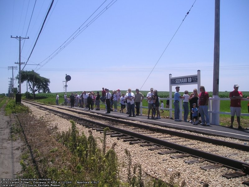 Passengers at Forest Park wait for the next Westbound car to arrive.