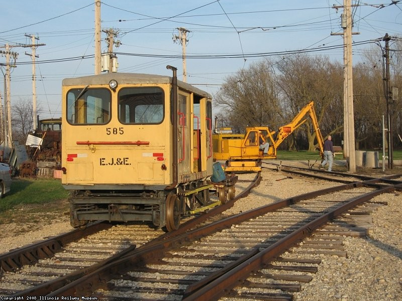 "EJ&E 585 and tool cart sit on the ""west leg of the tail track wye"""