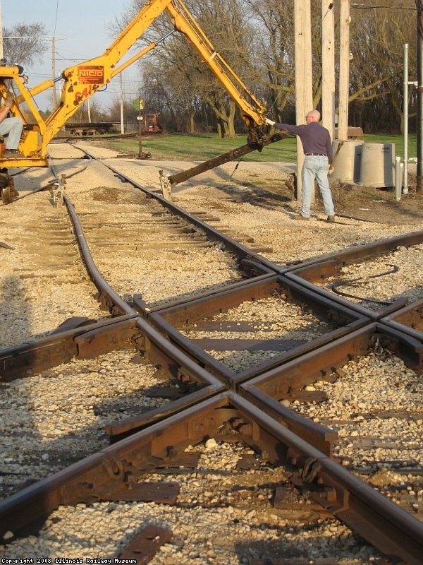 The track is raised, final job is replace 2 ties under a joint