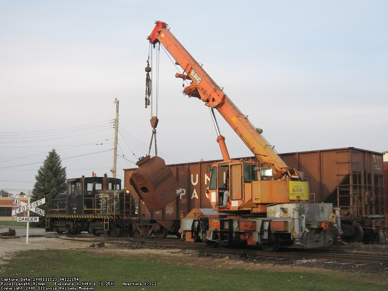 Lowering the 1800's locomotive firebox to the pallet