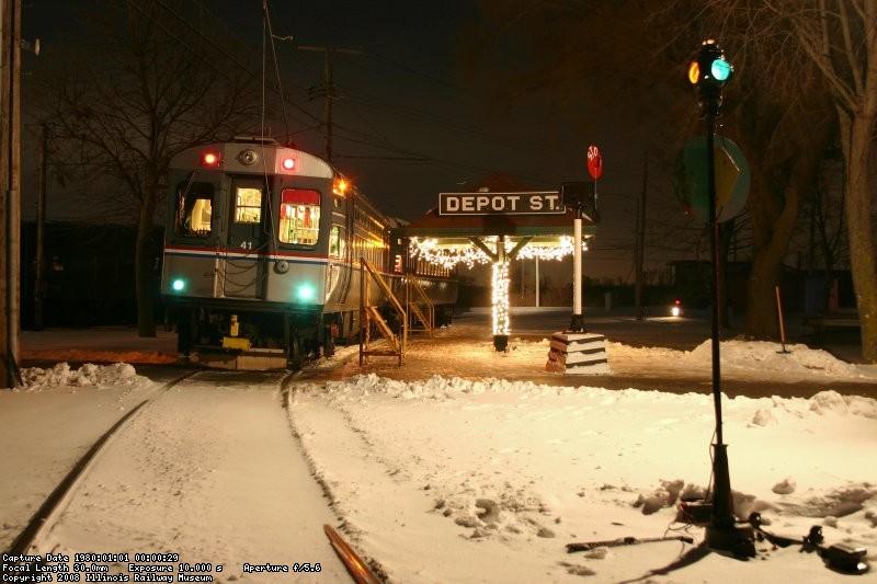 Waiting at Depot St (lit switch lantern)