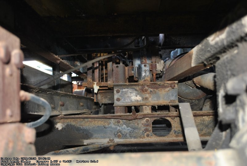 Looking toward the front of the machine. A lot of the support in the center is for a turntable that doesn't exist anymore.  The hole in the frame is where the second drive shaft runs between the two axles