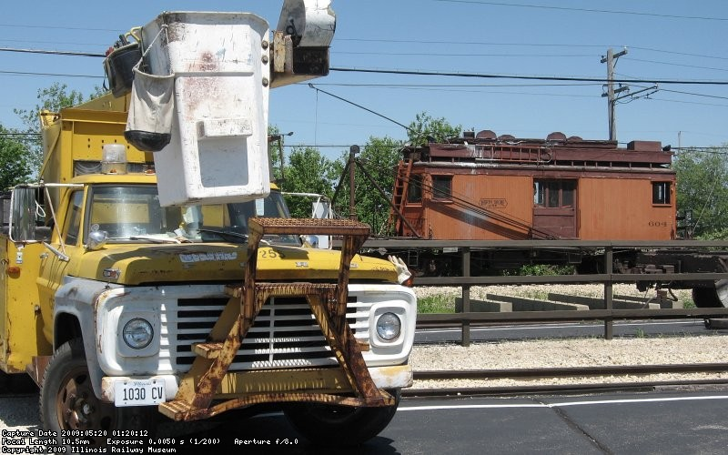 Bucket truck and line car at the depot