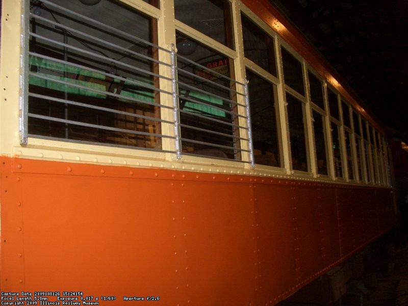 08.26.09 - PAINTING OF THE SECOND SIDE OF THE 972 IS COMPLETE.  pETE WASHED THE WINDOWS TODAY AND HAS INSTALLED THE TWO END WINDOW GUARDS.