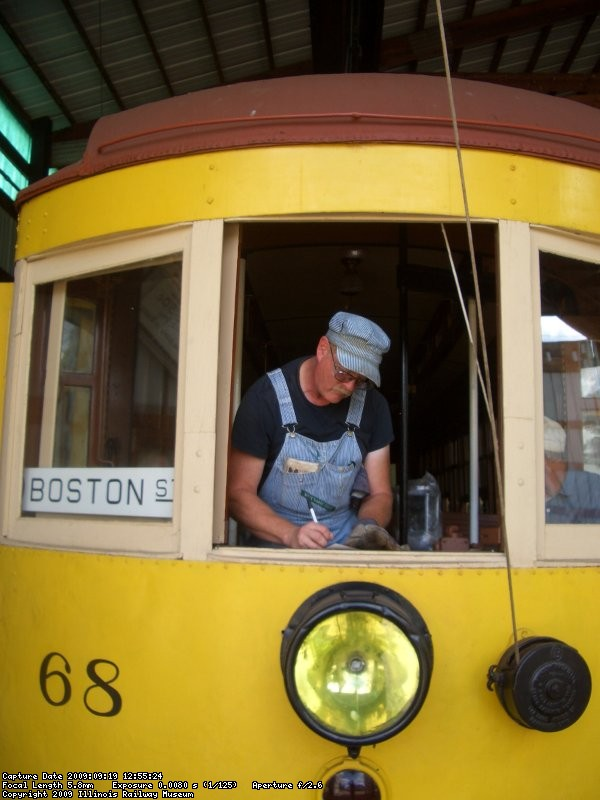 09.19.09 - WES IS COMPLETING A CAR CARD ON THE SS68 PRIOR TO ITS APPEARANCE ON THE TROLLEY LOOP.