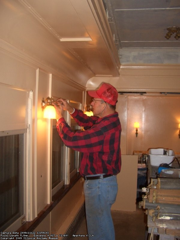 11.22.09 - ROGER KRAMER IS APPLYING THE LIGHT FIXTURES TO THE INTERIOR OF THE DOVER STRAIT.