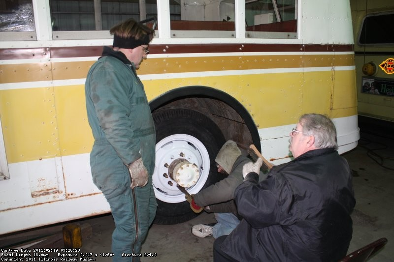 Richard, Bill and Wally in the midst of mounting the street-side rear tires.  02/19/2011