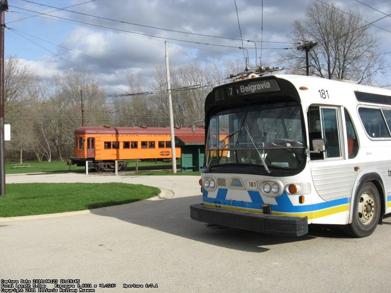 Edmonton BBC 181 sits in front of the Andersen Garage as IT 518 occupies the carline 04/23/2011.