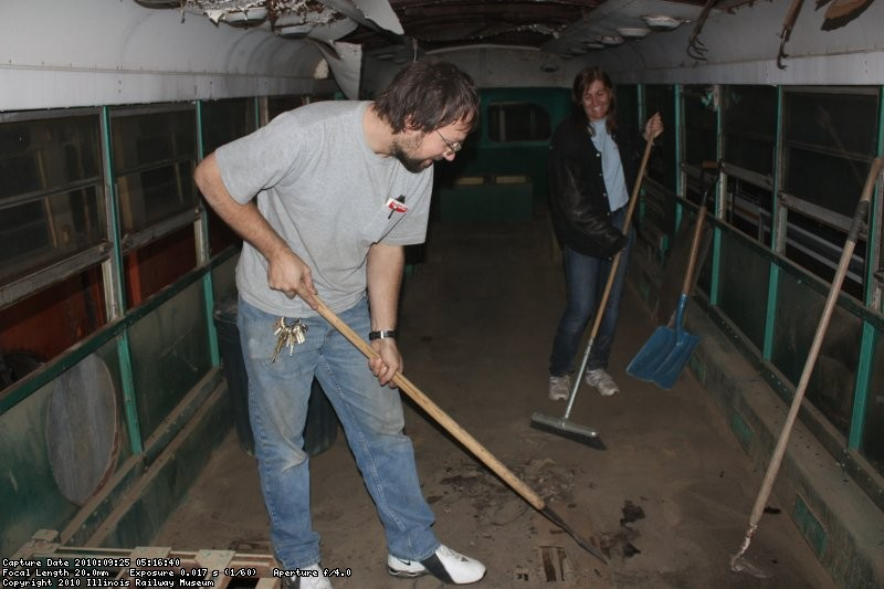 Richard Schauer and Julie Piesciuk taking up the old rubber flooring on the LA Brill 8002 09/25/2010