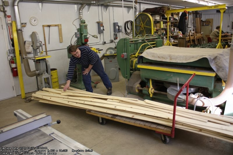 Bill Moran stacks up the completed roof planks - 01/22/2011.