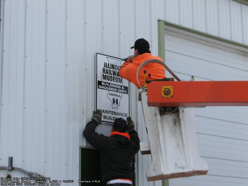 Putting up the new B&G Dept sign (03/12/2005).