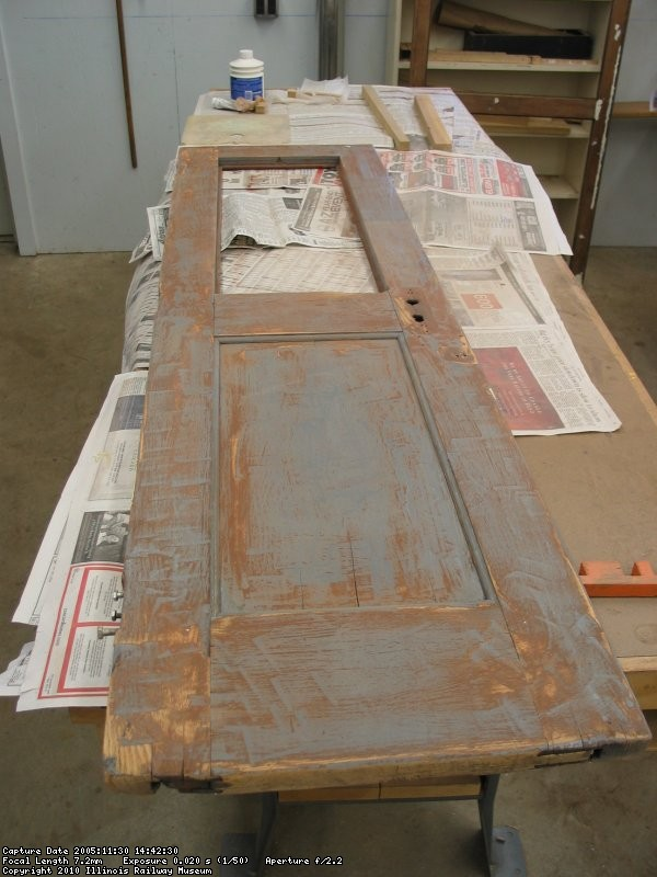 Original front door being restored