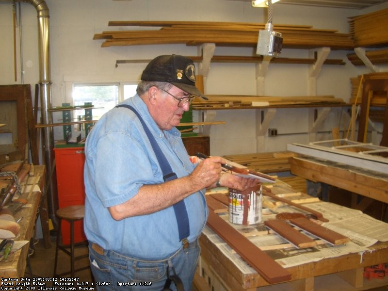 08.12.09 - JIM GRIFFITH IS PRIMING SOME OF THE SIDING PIECES MILLED TODAY.  KIRK WARNER MILLED 25 LOWER DOOR PIECES, TWO SIDE DOOR TRIM PIECES AND ONE PIECE OF SIDING, WHICH WILL COMPLETE THE WOOD REPLACEMENT ON THE CAR.