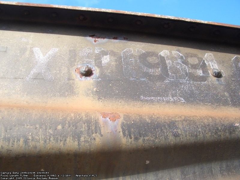 "10.04.09 - AS I CONTINUED TO NEEDLE CHIP THE ""A"" END OF THE CAR, I CAME ACROSS THE CAR'S PREVIOUS NUMBER, URTX 1099.  THIS WAS PROBABLY THE NUMBER WHEN IT WAS STILL AN ICE BUNKER REEFER."