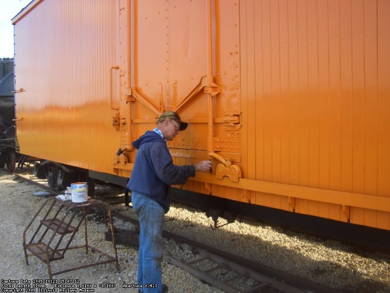 10.21.09 - VICTOR DOES MORE TOUCH-UP ON THE ORANGE.  HE ALSO PAINTED THE STEEL MEMBER BELOW THE DOOR BLACK.