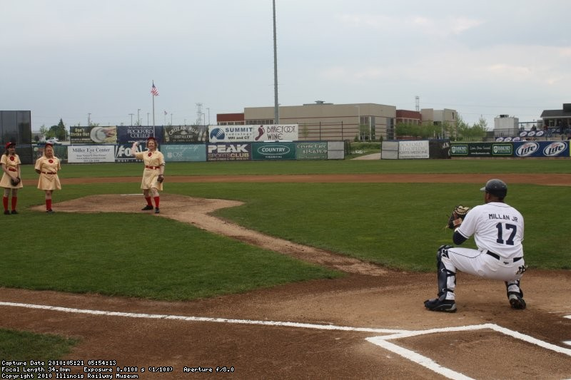 Rebecca, representing IRM, throws out the first pitch.