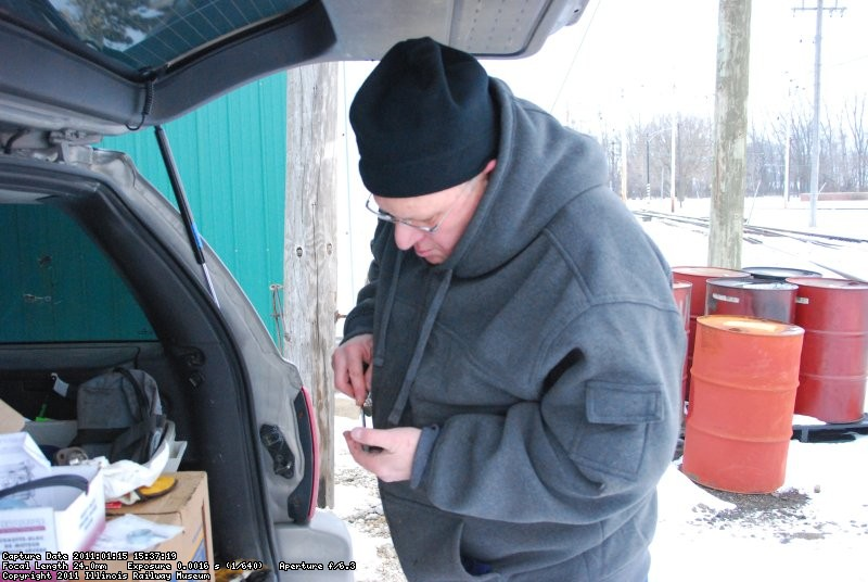 Marcus cleaning up the block heater mount.