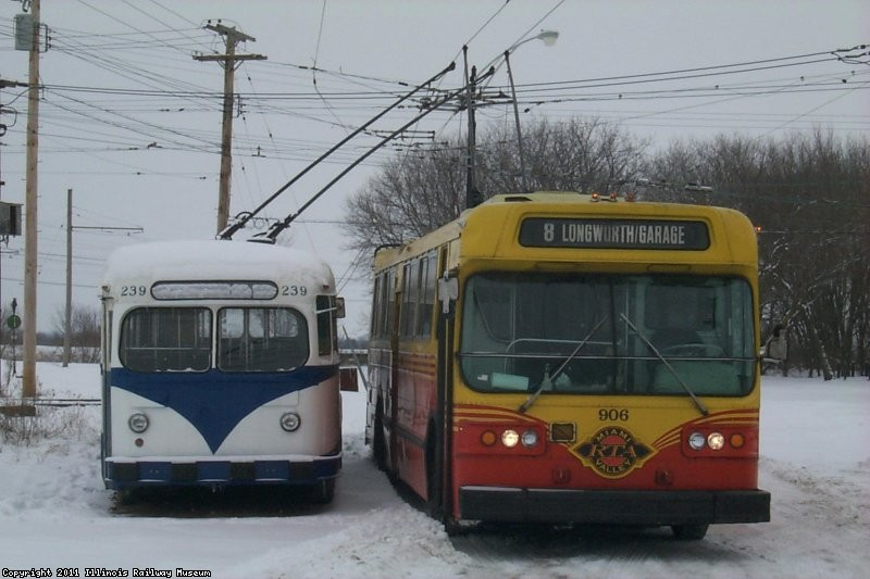 "Dayton Flyer 906 and Des Moines ""Curbliner"" 239 out for a ride in the snow (01/2000)."