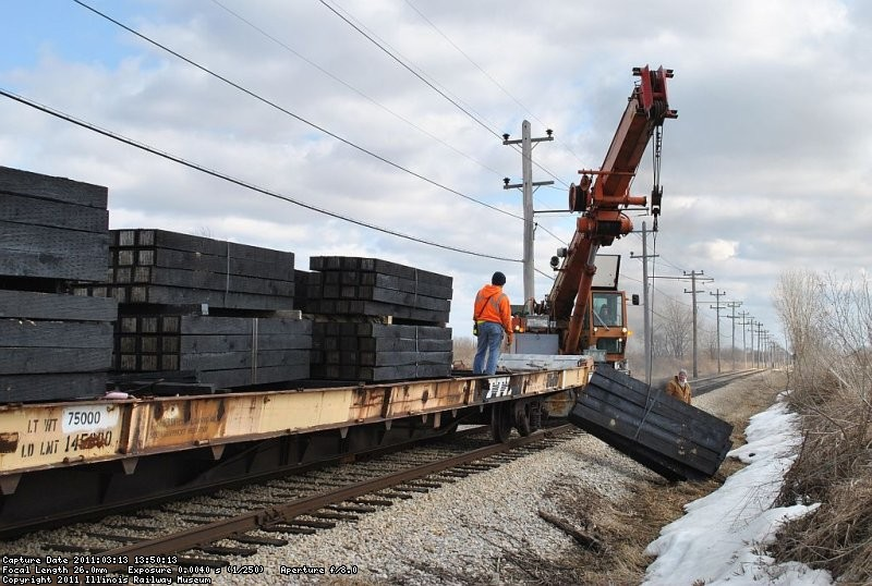 Unloading bundles of 20 & 25 along the mainline. 3-13-11