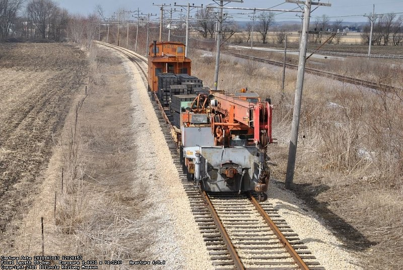 Work train with caboose and new ties heads out to drop off the bundles 3-13-11