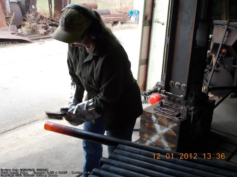 Yes, that's one of our lady volunteers cleaning the tube after it has been heated.  12-1-2012
